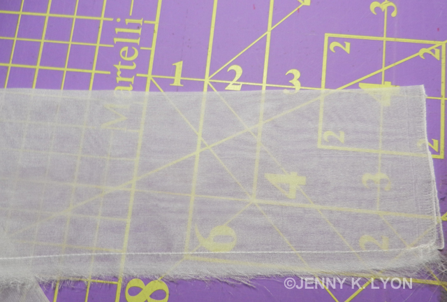 Seamed and pressed quilt hanging sleeve