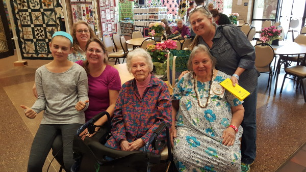 Matriarch Lenore Dean, daughter Carol Wilhelms, grand daughters Diane Wilhelms and her 2 sisters plus great grand daughter who modeled in the Fashion Show-4 generations!