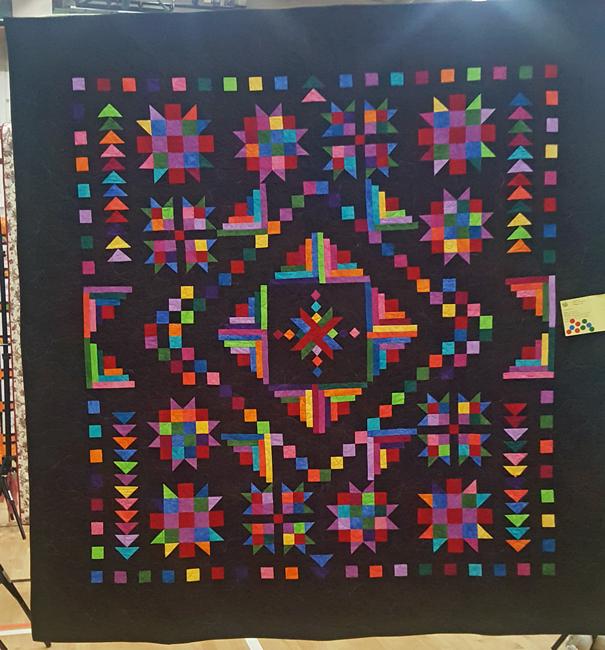 Fiesta of Stars, Lynne Hanson, quilted by Linda Konkle